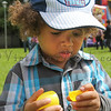 Lincoln Staricka looks inside his egg at The Petaluma Mother's Club  Easter Egg Hunt at McNear Park on April 12, 2014