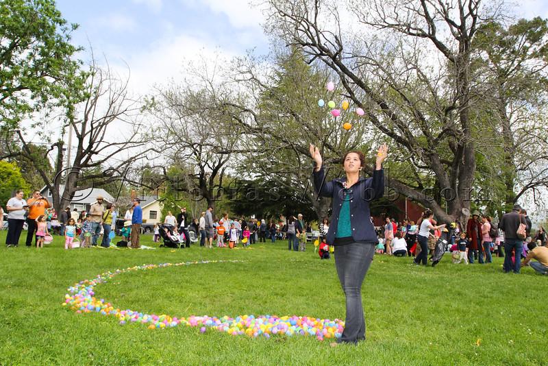 Volunteer Parmeeta Ghoman throws eggs at The Petaluma Mother's Club Easter Egg Hunt at McNear Park on April 12, 2014