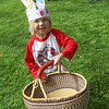 Noa Berka  readys her basket at The Petaluma Mother's Club  Easter Egg Hunt at McNear Park on April 12, 2014