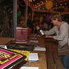Stephana McClaran looks at the auction goods. On Monday Feb 24, 2014 The Petaluma Music Festival held a Mardi Gras fundraiser at  Lagunitas.