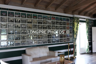 Inside POLO CLUBHOUSE.  Framed photo wall.