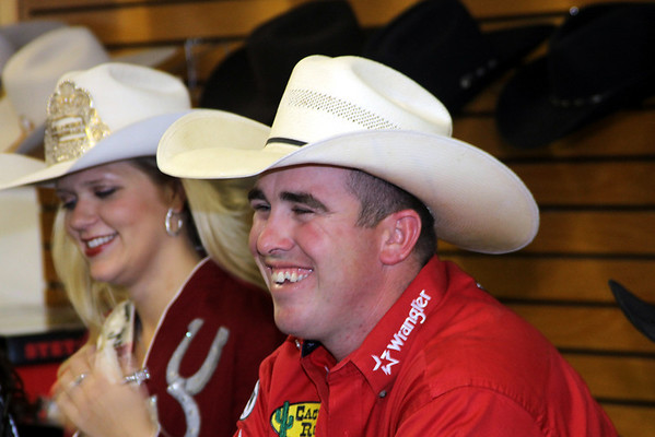 Ryan Jarrett, a World Champion cowboy and Comanche resident, enjoys conversation at the autograph reception held Wednesday, Oct. 17, 2012, at Crutcher's Western Wear. Seen in background is Miss Rodeo Queen Nebraska Sierra Peterson.