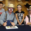 From left, Blayden Foster, Justin Rumford, Kaylee Foster, and Miss Rodeo Queen Kansas Heather Temple, pose for a photo at Crutcher's Western Wear.