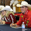 Miss Rodeo Queen Nebraska, Sierra Peterson, and World Champion cowboy Ryan Jarrett of Comanche, visit with children during the autograph signing to promote the PRCA Prairie Circuit Finals Rodeo which begins Thursday, Oct. 18 and continues through Oct. 20, in Duncan.