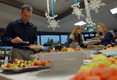 Hinsdale Central faculty members including English teacher Rob Aurich enjoy a meal during the appreciation holiday party and breakfast held by PTO members Thursday Dec. 20, 2012. Erica Benson—ebenson@shawmedia.com