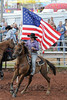 Rider carries flag during the National Anthem.
