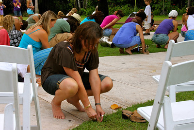Festival-goers take part in a seed planting ceremony.