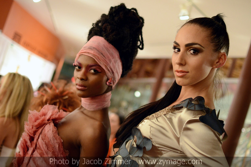 """Models Aube Jolicoeur and Sarah Terry in wearable art participate in the """"Art Walks the Runway"""" show at the KY Museum of Art & Craft. April 12, 2013."""