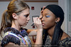 """Lillian Waters and Myah Winbush get prepared in the dressing room before the """"Art Walks the Runway"""" show at the KY Museum of Art & Craft. April 12, 2013."""