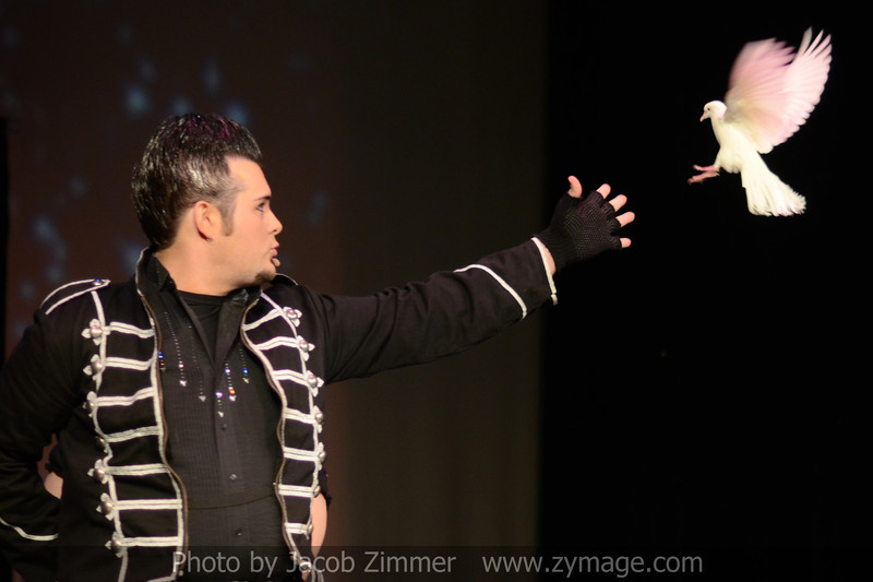 Illusionist Reed performs a trick in the opening act to the pageant.