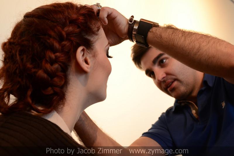 Model Jacey Calloway has eye lashes applied by stylist Isidiro Valencia.