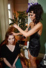 Stylist Tammy Wiseman works on model Kaitlyn Tew's hair in the dressing room before the show.