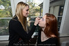 Stylist Cassie Lynn Young applies make up on model Kaitlyn Tew.