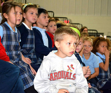 Debbie Blank | The Herald-Tribune Kindergartners (front row from left) Ethan Meer, David Koch, Nash King, Mimi Smith; (back row) Grace Gutzwiller, Campbell Miles, Matthew Lambert and Carson Hartwell are riveted by Bramblitt and his dog.