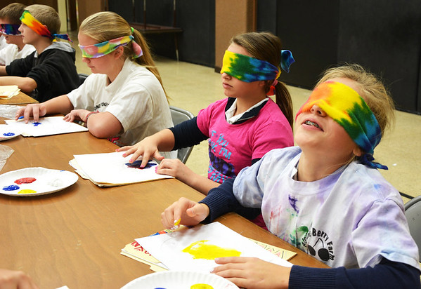 Debbie Blank | The Herald-Tribune Students (from right) Kathryn Wilder, Abbey Prickel, Samantha Tonges and Dominic Butz get used to having no vision.