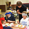 Debbie Blank | The Herald-Tribune<br /> John Bramblitt encourages seventh-graders Jayden Rose (left) and Lily Esser. The artist also mentored students at Batesville primary, intermediate and high schools during a visit organized by the Rural Alliance for the Arts for its Arts in Education Program.