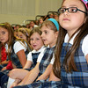 Debbie Blank | The Herald-Tribune<br /> Listening to the artist are (from right) second-graders Veronica King, Isabel Raab, Kenzie Maple and Lucy Abplanalp.