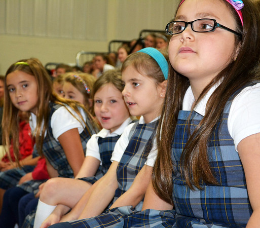 Debbie Blank | The Herald-Tribune Listening to the artist are (from right) second-graders Veronica King, Isabel Raab, Kenzie Maple and Lucy Abplanalp.