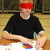 Debbie Blank | The Herald-Tribune<br /> Seventh-grader Joshua Myers uses his fingers to determine where to paint.