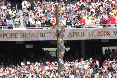 The Processional Cross from the Shrine enters the Stadium.