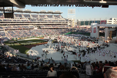 April 17: A maximum capacity of 47,000 people begin to assemble for the Papal Mass (of the the Holy Spirit) at the brand new Nationals Stadium.