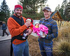 Trading Places - These two new dads are trying each others infants (4 & 6 wks old) on for size during the 2013 Christmas Parade in Sisters, Oregon - Copyright © 2013 Gary N. Miller, Sisters Country Photography