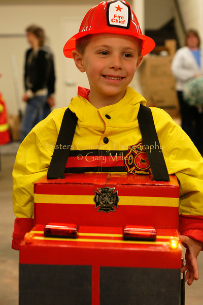 McAllistar McIntyre has the right costume at the Sisters Fire Hall. Halloween 2008. Gary Miller - Sisters Country Photography