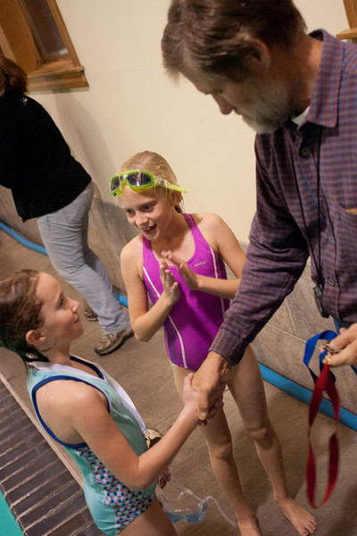 World Champion swimmer Tom Landis congratulates the winners as he personally hands out the medals to them. Sisters Athletic Club swim competition. Nov 6, 2009. Gary Miller - Sisters Country Photograpny