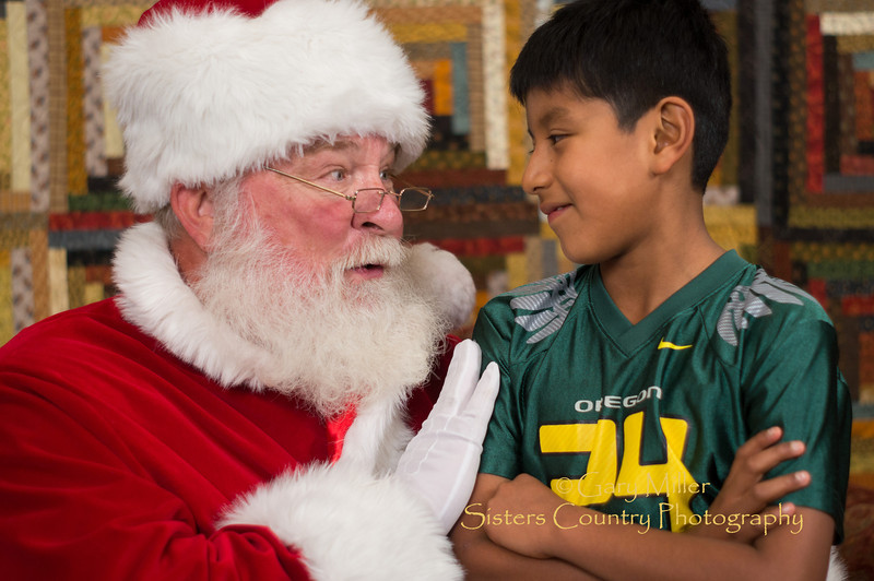 Santa Claus comes to visit the children of Sisters Country at the Chamber of Commerce in Sisters, Oregon on November 24, 2012 - Gary N. Miller - Sisters Country Photography