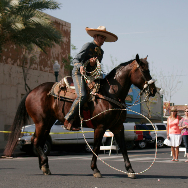 The Charros de la Federacioin Mexicana de Charreria entry in the 2014 OBF parade included a trick roper.