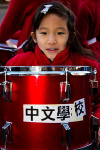 Cheryl Chen (9) from Taiwan marches for the TECRO Chinese School