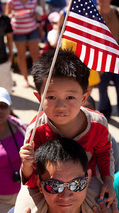 young Derui Zhang from China listens to a  dramatic reading of the Delaration of Independence during tthe July 4 Celebration at the National Archives