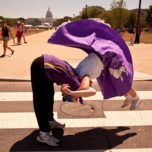 Valerie Pyle (Warrenton, Va.) and David Engler  (Fairfax VA) do the Lindy Hop on the National Mall. Capitol in background.