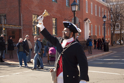 Town Crier Benjamin Fiore-Walker announces the parade