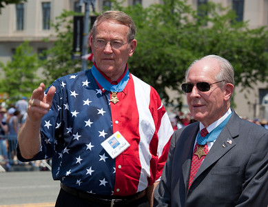 The guests of honor included Thomas Hudner (right), a Navy captain who won the Medal of Honor for his actions in the Korean War, and Roger Donlon (left), a retired Army officer who served in Vietnam and also received the Medal of Honor.