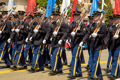 Members of the United States Army Honor Guard march at the head of the parade.