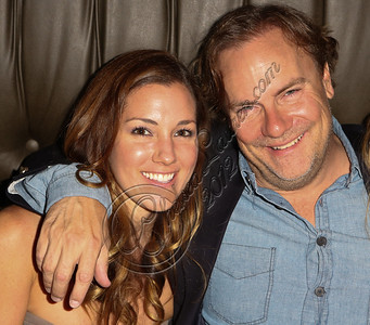 "LOS ANGELES, CA - JULY 29:  Director Kevin Farley (R) and actress Carly Craig attend the ""Paranormal Movie"" wrap party at The Writer's Room on July 29, 2012 in Los Angeles, California.  (Photo by Chelsea Lauren/WireImage)"
