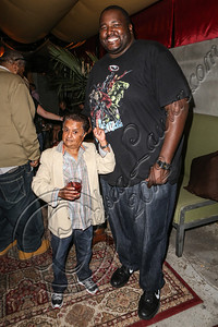 "LOS ANGELES, CA - JULY 29:  Actors Deep Roy (L) and Quinton Aaron attend the ""Paranormal Movie"" wrap party at The Writer's Room on July 29, 2012 in Los Angeles, California.  (Photo by Chelsea Lauren/WireImage)"