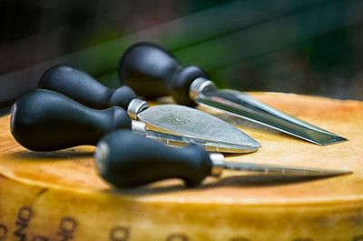 The knives used to crack a wheel of Parmigiano-Reggiano.