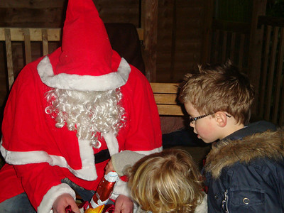 The kids help themselves to Santa's sack.