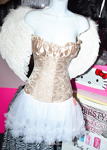 Angel wings are always in at the Kinky-Kitty.