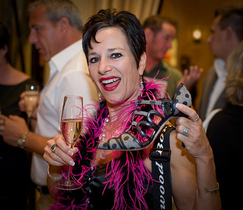 "Download or purchase a printed photo of guests at the Manolo Blahnik Shoe Salon Party at Wynn Hotel & Casino in Las Vegas drinking Moet Champagne and shoe shopping in celebration of the famous blue proposal shoe in ""Sex In The City."""