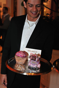 """Download or purchase a printed photo of guests at the Manolo Blahnik Shoe Salon Party at Wynn Hotel & Casino in Las Vegas drinking Moet Champagne and shoe shopping in celebration of the famous blue proposal shoe in """"Sex In The City."""""""