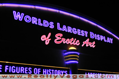 Buy print or download of photo of Erotic Museum in Las Vegas by Las Vegas photographer Mark Bowers Copyright All Rights Reserved.  Fire eaters and fire twirlers were on hand to entertain the costumed guests. The Erotic Museum is both erotic and pornographic with artwork ranging from Japanese prints, primitive sculptures, gigantic sculptures to mannequins depicting  actors making porno movies. There are even old time video arcades - The Erotic Museum of Las Vegas is extensive and takes up 2 large floors. There is also a very large gift shop.