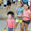 KynLynn Grant, 3, Carly Spittler, 9, and RyaLynn Grant, 6, all of Camanche enjoy the free entertainment during Camanche's Party in the Park on July 19 in City Park. • Katie Dahlstrom/Clinton Herald