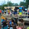 Colton Shields, of Camanche, plays pop songs on his saxophone on July 19 during Camanche's Party in the Park in City Park. • Katie Dahlstrom/Clinton Herald