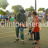 Shocko the Clown uses volunteers during his show to entertain the crowd at Camanche's Party in the Park on July 19 in City Park. • Katie Dahlstrom/Clinton Herald