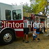 Maddox Homan, 5, of Camanche, exits a Camanche fire truck after a tour during Camanche's Party in the Park on July 19 in City Park. • Katie Dahlstrom/Clinton Herald
