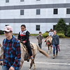Sam Luptak Jr./NEWS<br /> Brothers Timothy, 6, front, and Alex, 5, ride the ponies provided by Squawk Creek Stables and the Mill Street Merchants.