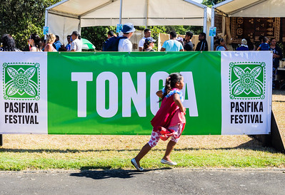 Young girl running in front of Tonga sign Pasifika Western Springs